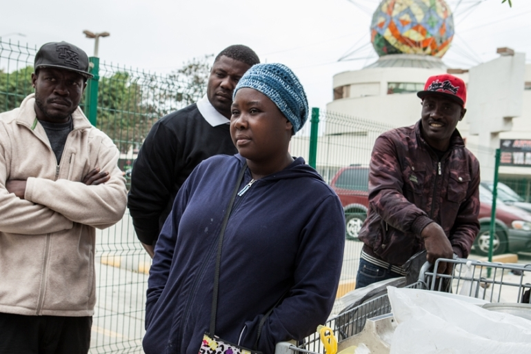 'Cecile', a Haitian migrant, sells Haitian food from her cart to the Haitian and Mexican community in Zona Norte.  [Al Jazeera/ Jessica Chou]