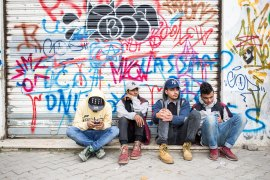 Young people from the local hip-hop community await the opening of the festival. [Emeric Fohlen/Al Jazeera]