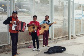 Travellers from the US are greeted with Ranchera music on entering the pedestrian corridor in Tijuana, Mexico [Jessica Chou/Al Jazeera]
