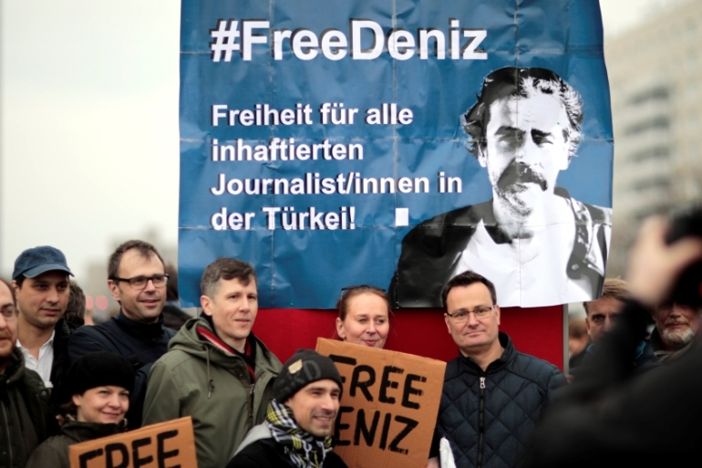 Protesters called for the freedom of Yucel during a rally in the streets of Berlin [Axel Schmidt/Reuters]
