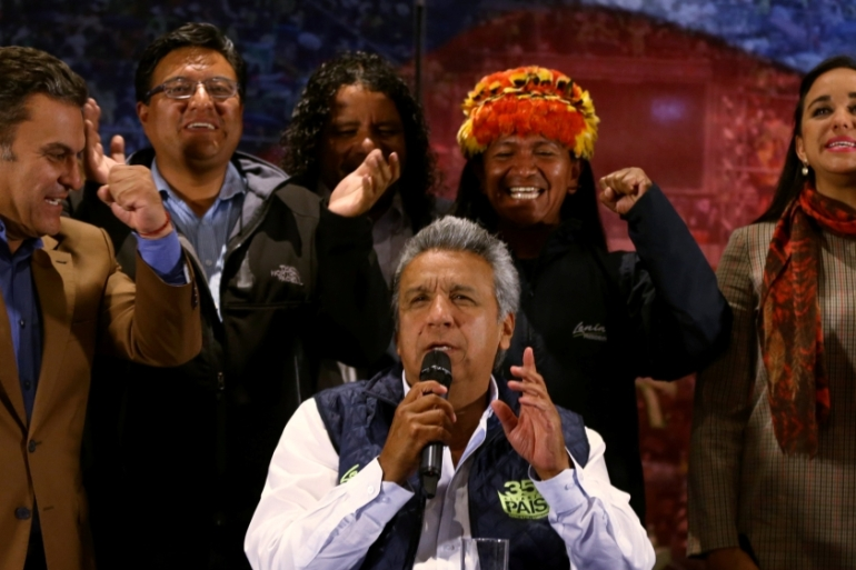 Moreno (centre) needed 40 percent of votes to win outright [Mariana Bazo/Reuters]