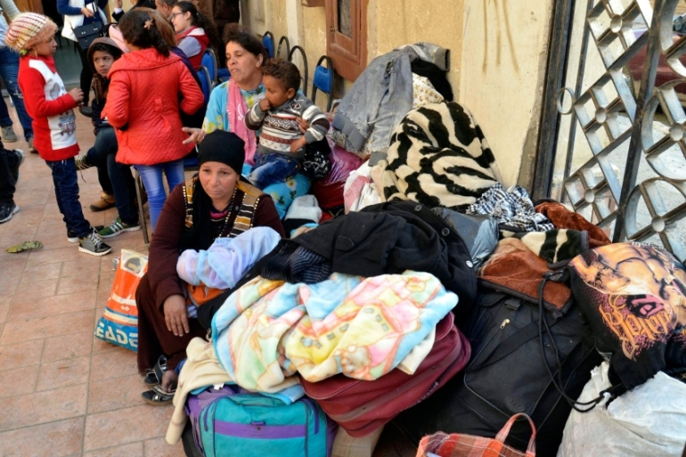 An estimated 150 families - more than 400 people - fled their homes in El Arish [EPA]