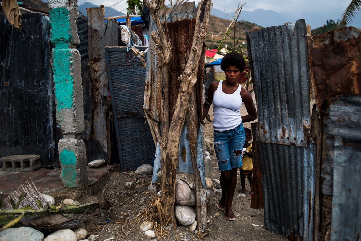 After homes were destroyed by the storm's strong winds, most walls in Les Anglais are now made from scavenged materials. [Alex McDougall/Al Jazeera]
