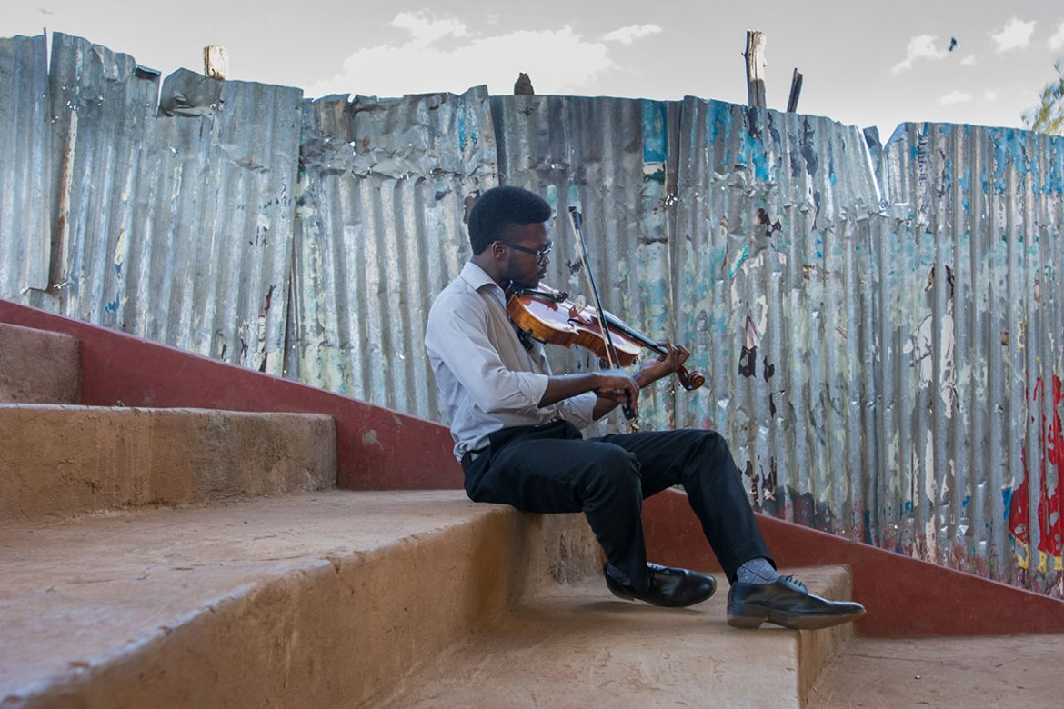 Edwin, 24, was one of the first members of the orchestra. He now teaches the viola, which is not to be mistaken with the violin. 'A real orchestra really needs a viola,' he says. 'Music always changes my mood. It makes me feel at peace. [Eva de Vries/Al Jazeera]