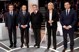 French presidential election candidates Francois Fillon, Emmanuel Macron, Jean-Luc Melenchon, Marine Le Pen and Benoit Hamon, pose before a televised debate on March 20 [Patrick Kovarik/Reuters]