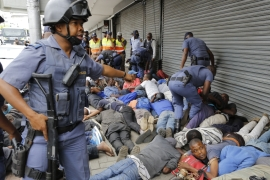 Members of the South African Police forces patrol an area in Johannesburg where local South African men attacked shops owned by foreign nationals on February 24 [EPA]
