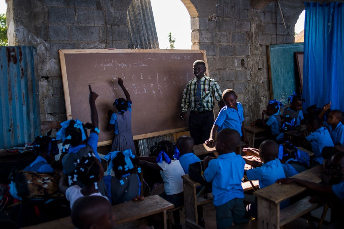 Young Haitians resumed school in Les Anglais two months after Hurricane Matthew. Teachers hung tarps to divide classrooms at Mission Evangelical Baptist Church after the storm destroyed their schoolhouse. [Alex McDougall/Al Jazeera]