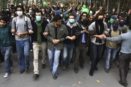 Pro-reform Iranian students march during protests at the Tehran University campus on December 7, 2009  [AP]