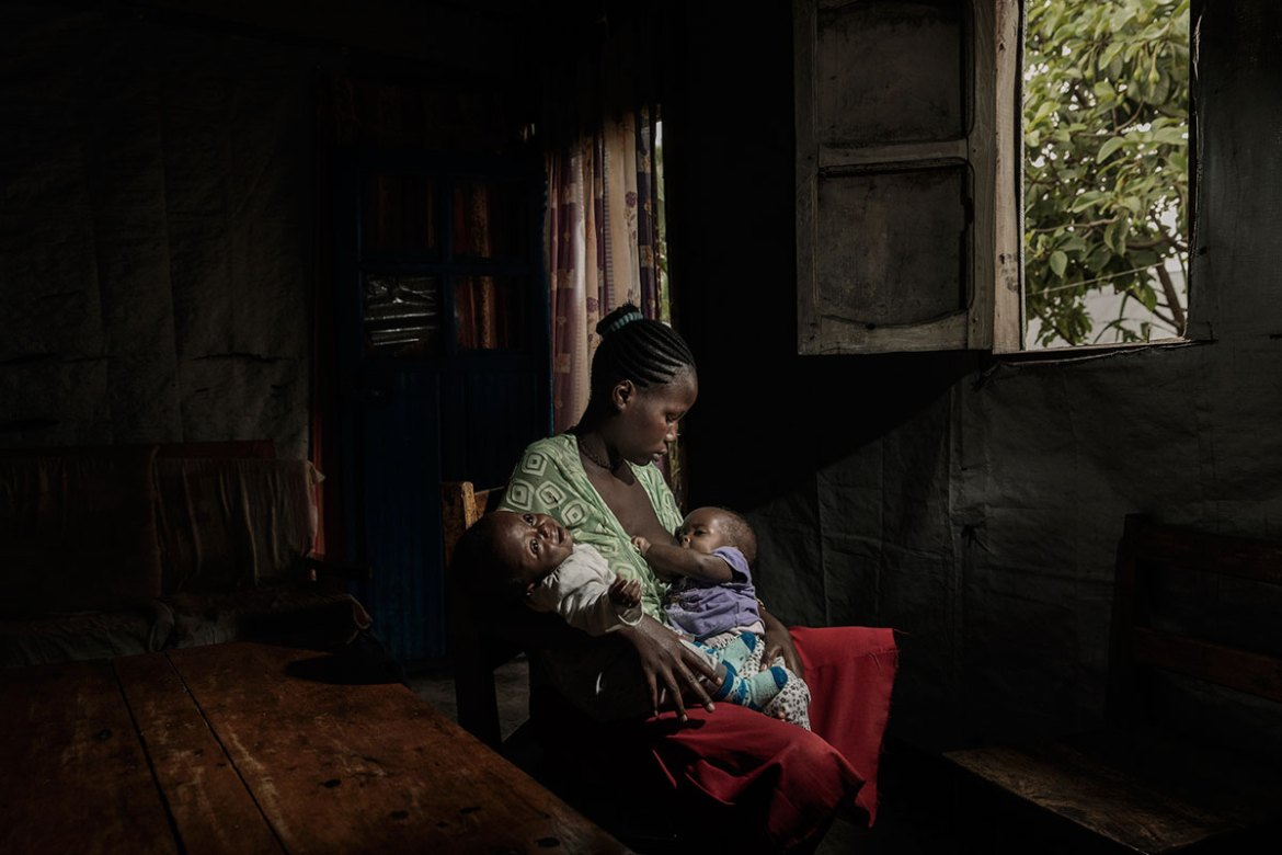 Ombeni,13, was raped and became pregnant. She gave birth to twins last August. She lives with her mother and a close female relative, but she has been ostracised and isolated by her community. The Italian NGO AVSI is providing her with social and medical support. [Marco Gualazzini/Al Jazeera]