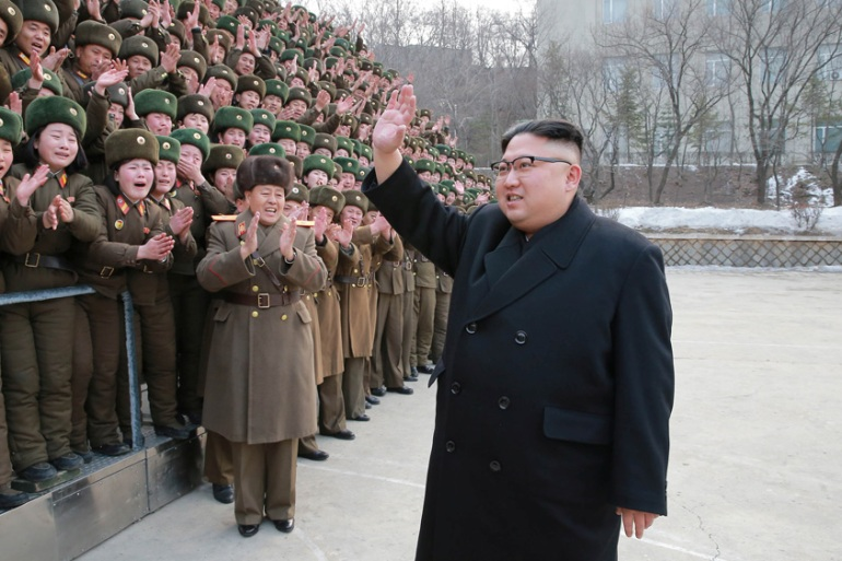 Kim Jong-un inspects a military base in this undated photo released on March 1 [Reuters]