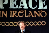 Martin McGuinness speaks to reporters at a news conference during his time as the Sinn Fein chief negotiator on February 26, 1999 [Paul Hackett/Reuters]