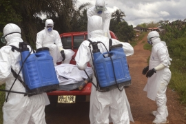 Health workers load the body of a woman suspected of dying from Ebola on to a truck in Jene-Wonde, Liberia, on November 8, 2014. [AP Photo/Wade Williams]