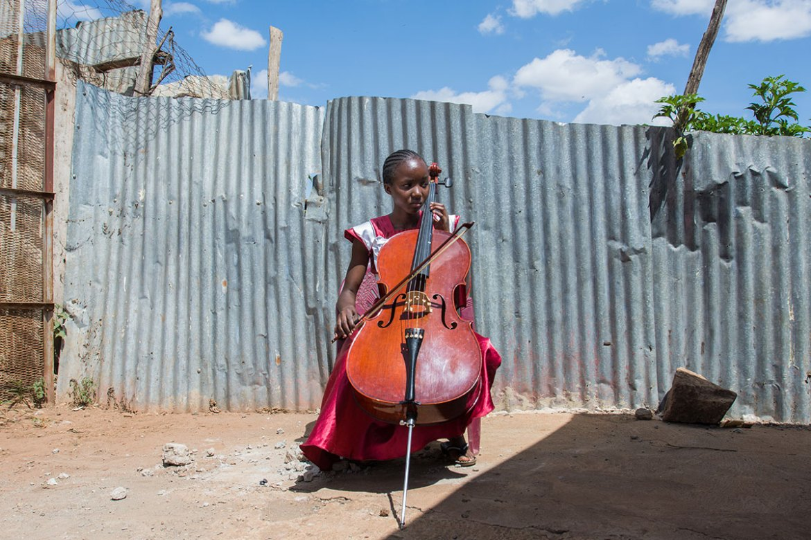 Maryanne, 15, who is shy and small for her age, decided to play the cello. 'Playing a big instrument makes me feel so powerful.' [Eva de Vries/Al Jazeera]