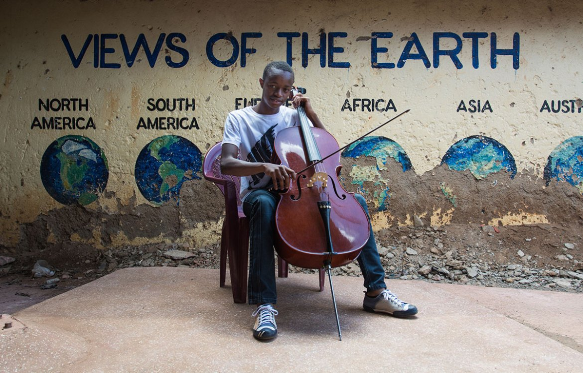 'Music gives me joy and helps me achieve my goals,' Nelson, 16, says. And his goals are ambitious. 'I want to travel the world as a musician.' [Eva de Vries/Al Jazeera]
