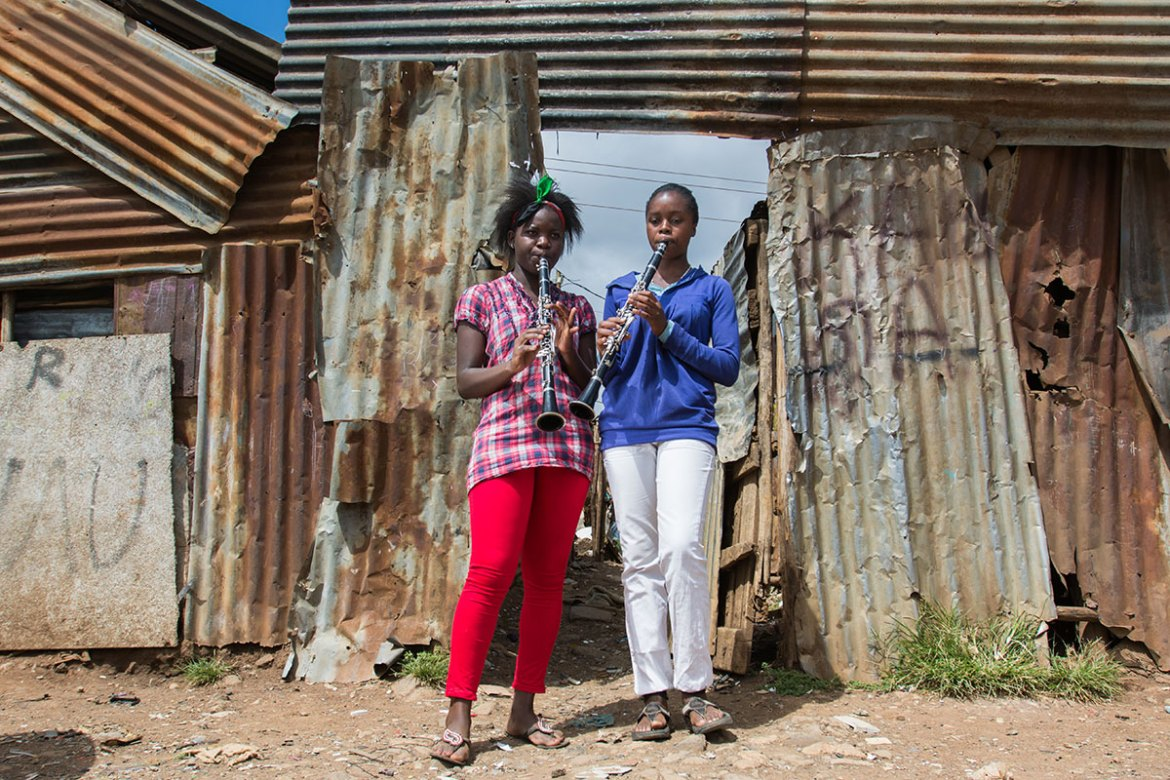 Linet, 17, and Lewinsky, 18, are friends who play the same instrument. 'We really like playing together in the orchestra. When we play, we are like one big family.' [Eva de Vries/Al Jazeera]