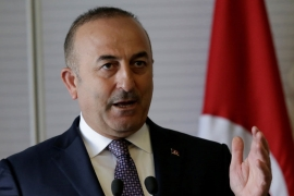 Cavusoglu threatened the Netherlands with sanctions if his visit was blocked [File: Henry Romero/Reuters]