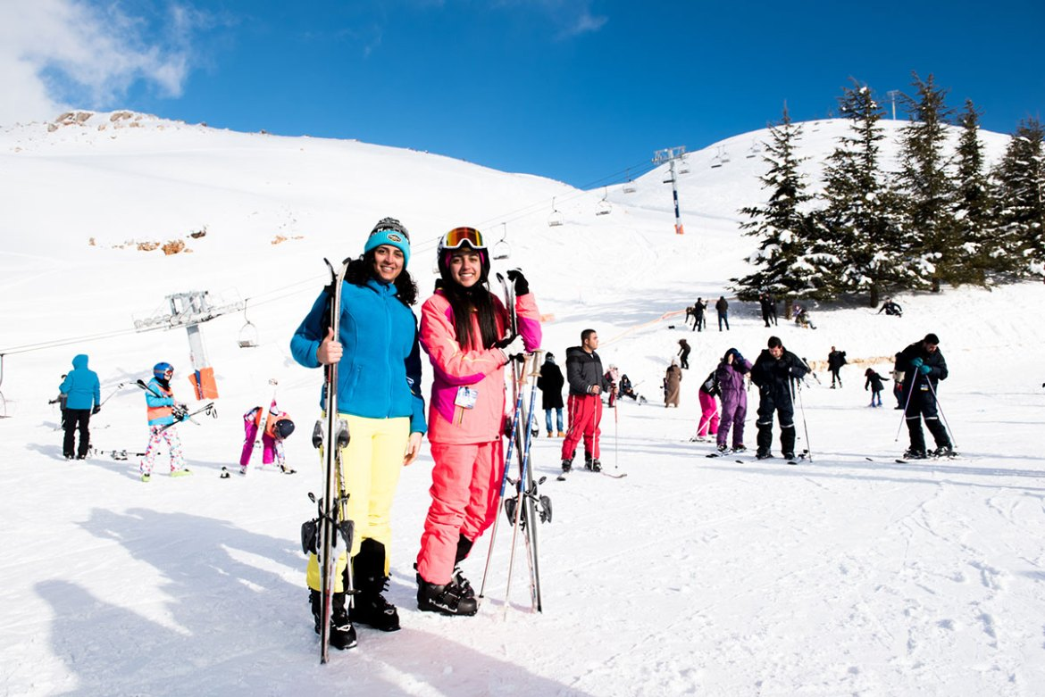 For cousins Nour and Sandra, this is their first time at the resort; they usually ski at another resort in Lebanon. Skiing is a passion for their whole family, they said. [Constance Decorde/Al Jazeera]