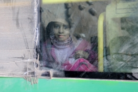 A girl rides a bus to be evacuated from a rebel-held sector of eastern Aleppo, Syria, December 18, 2016 [Abdalrhman Ismail/Reuters]