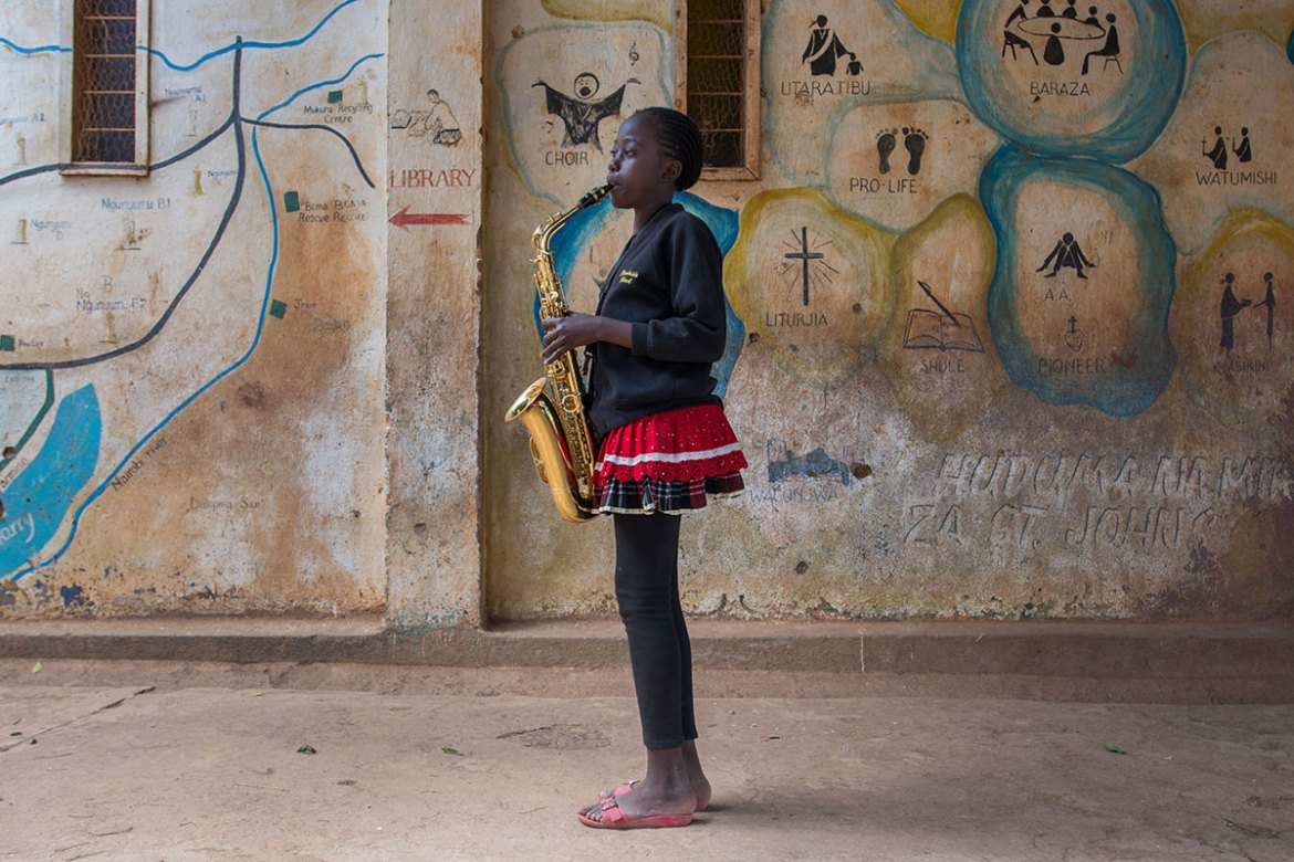 'Sometimes I can't stop looking at my saxophone,' says Welma, 11. 'It's just so beautiful and it makes a great powerful sound.' [Eva de Vries/Al Jazeera]