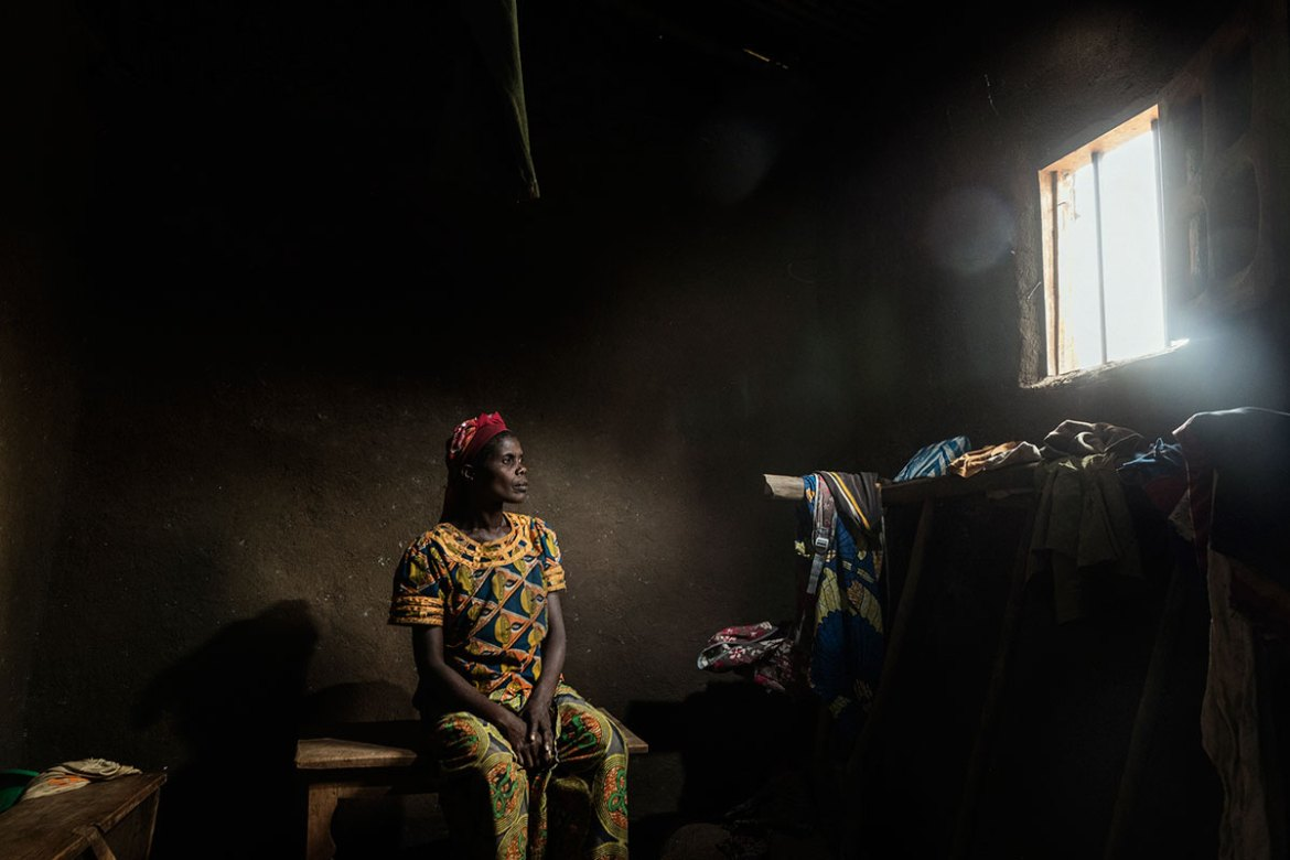 Maria Gnabajumba, 40, was raped for two days by an armed group on the orders of the children of her husband's first wife. She has told her story to no one, for fear of discrimination and of being repudiated by her husband, who rejected his first wife after she had also been raped. [Marco Gualazzini/Al Jazeera]