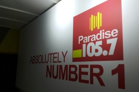 At Paradise FM they no longer just play love songs but also take calls from listeners to discuss politics and current affairs. [Hamza Mohamed/Al Jazeera