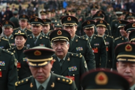 Military delegates arrive before the opening of the fifth Session of the 12th National People's Congress outside the Great Hall of the People in Beijing, on March 5 [EPA]