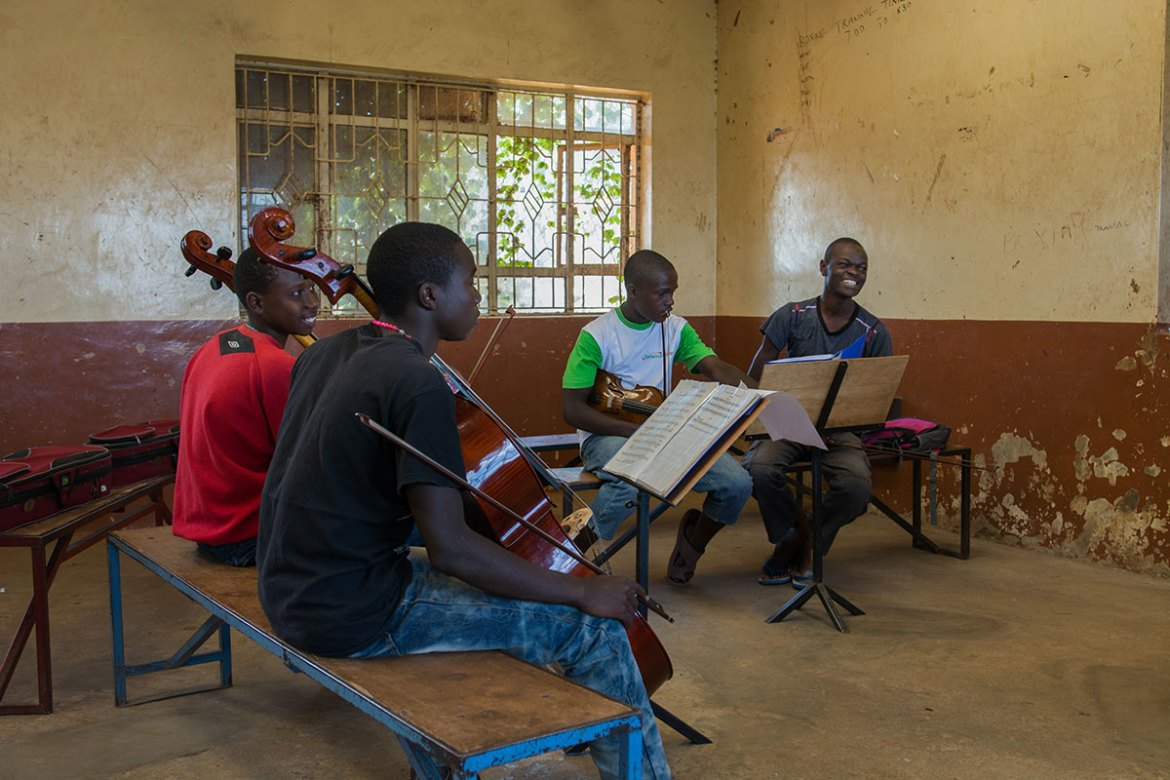 The string players are practising scales over and over again. [Eva de Vries/Al Jazeera]