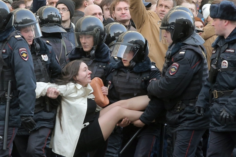 Russian riot policemen detain a demonstrator during an opposition rally in central Moscow on March 26, 2017 [EPA/Maxim Shipenkov]