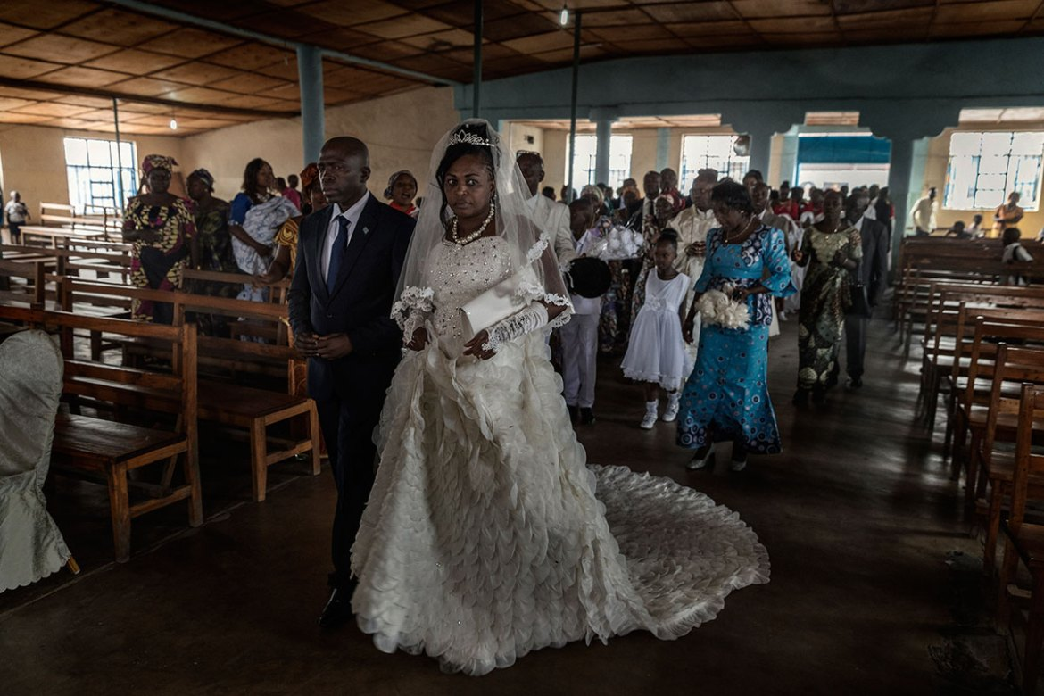 A marriage at the Paroisse St Francois Xavier. In the DRC, once a woman has been a victim of sexual abuse she is often abandoned by her husband and society. Victims often don't report the crime for fear of such repercussions, and many discover later that they have contracted venereal disease or that they are pregnant. [Marco Gualazzini/Al Jazeera]