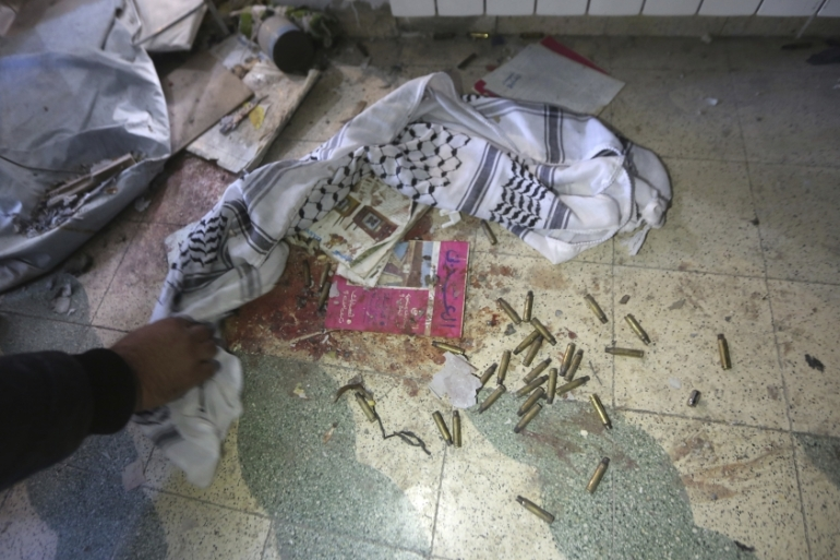 Empty bullet casings lie on the floor in the house where Basil al-Araj went into hiding, in the West Bank city of Ramallah [The Associated Press]