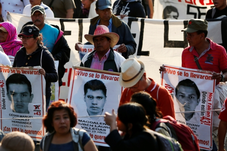 Demonstrators called on Mexican authorities to hold those responsible for the disappearances to account [Carlos Jasso/Reuters]