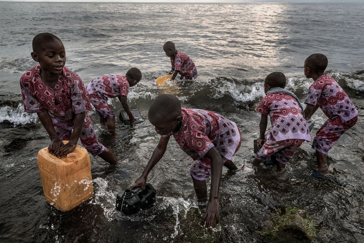 Children from the Tulizeni orphanage in Goma go to Lake Kivu every day to get water. The centre has taken in 74 girls and 200 women who have suffered sexual abuse in the past three years. [Marco Gualazzini/Al Jazeera]