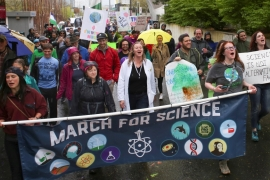 Protesters make their way through Seattle Centre during the March For Science in Seattle on April 22 [Reuters/David Ryder]