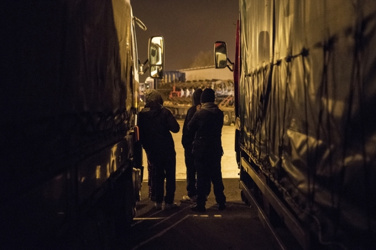 Young refugees in Calais wait before attempting to slip into trucks [Guillem Trius/Al Jazeera]