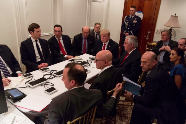 US President Donald Trump being briefed by Chairman of the Joint Chiefs of Staff General Joseph Dunford via secure video teleconference after a missile strike on Syria [Reuters/The White House]