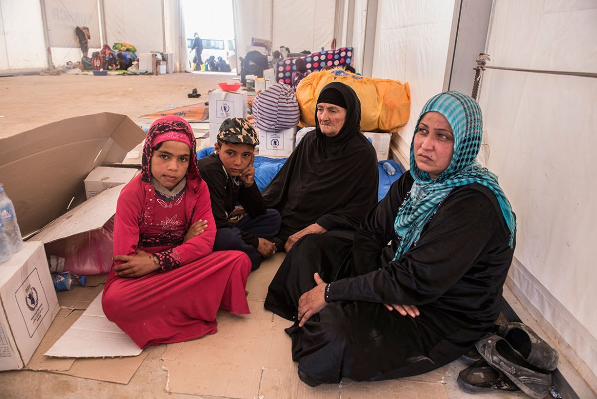 Amira (right) is 42 and fled Mosul on the March 28. She has eight children but fled with only one daughter, her mother and a nephew. She does not know if the rest of her family is alive or dead. 'We have lost everything, including our identification,' she said. Her home was destroyed by a car bomb. 'For 13 years, I had a grocery store, then ISIL came and destroyed it. Now we have nothing,' she continued. [Melany Markham/NRC/Al Jazeera]
