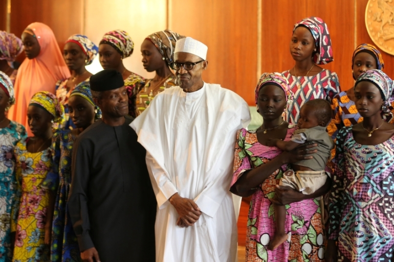 Some of the 21 Chibok schoolgirls released by Boko Haram pose with President Muhammadu Buhari and Vice President Yemi Osinbajo in Abuja, Nigeria, October 2016 [Afolabi Sotunde/Reuters]