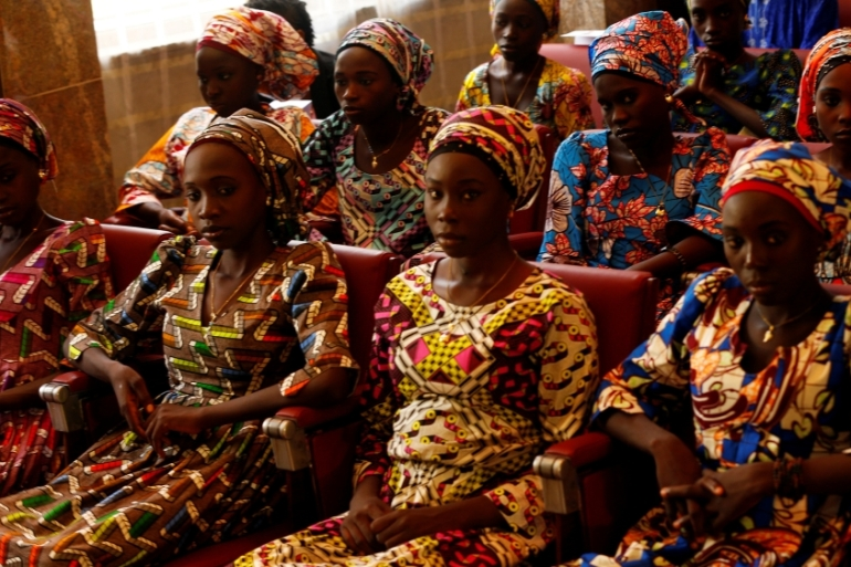 Some of the 21 Chibok schoolgirls released in October 2016 by Boko Haram look on before meeting the president [Afolabi Sotunde/Reuters]