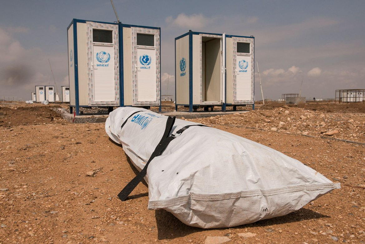 Pitching tents is the last thing to be done when constructing large displacement camps. This one will house around 30,000 people near the town of Hammam al-Alil. [Melany Markham/NRC/Al Jazeera]