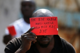A Congolese opposition party supporter displays a red card against President Joseph Kabila in Kinshasa, Democratic Republic of Congo December, 2016 [Reuters]