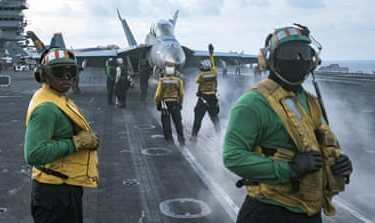 Sailors conduct flight operations on the aircraft carrier USS Carl Vinson on April 8 [Matt Brown/US Navy via AP]
