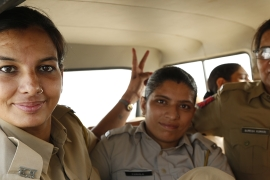 Constables Pooja, Sunila and Neelam from the Sonipat women's police station, Haryana state, India. [Rumi Hamid and Misha Maltsev]