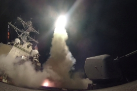 The US fired dozens of cruise missiles at an airbase in Syria, in retaliation for a suspected chemical weapons attack on a rebel-held town [Ford Williams/US Navy/Reuters]
