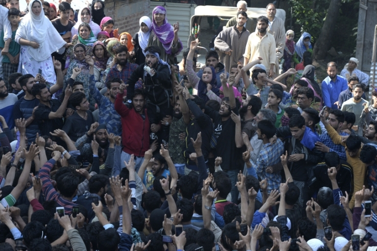 Thousands defied the security curbs to attend Bhat's burial in his hometown [Tauseef Musthafa/AFP]