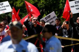 Pro-Erdogan demonstrators shout slogans at their counterparts on Tuesday in Washington DC [Jonathan Ernst/Reuters]