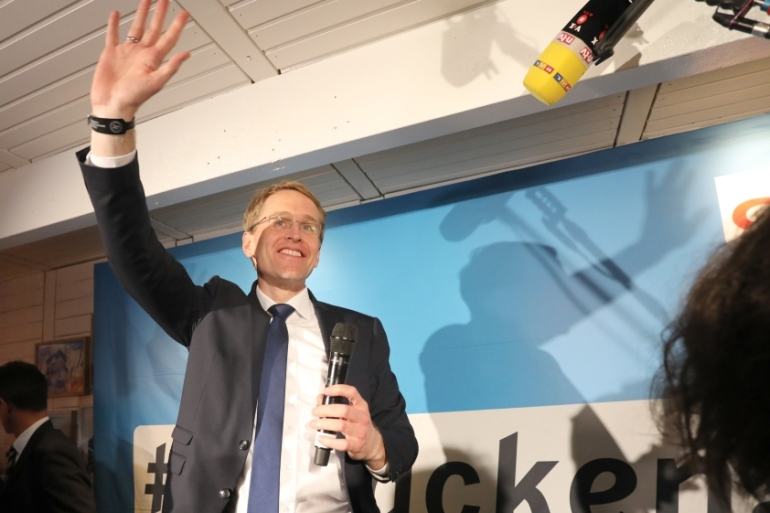 Daniel Guenther of the CDU celebrates his party's victory in key state elections [Focke Strangmann/EPA]