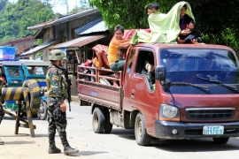 Government troops check a vehicle evacuating residents from their hometown of Marawi [Reuters]