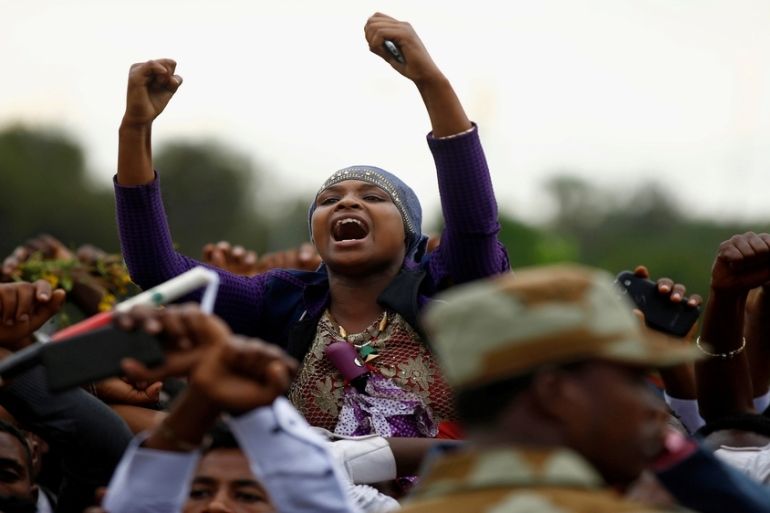 Demonstrators chant slogans while flashing the Oromo protest gesture during Irreecha, the thanksgiving festival of the Oromo people, in Bishoftu town, Oromia region, Ethiopia [Tiksa Negeri/Reuters]
