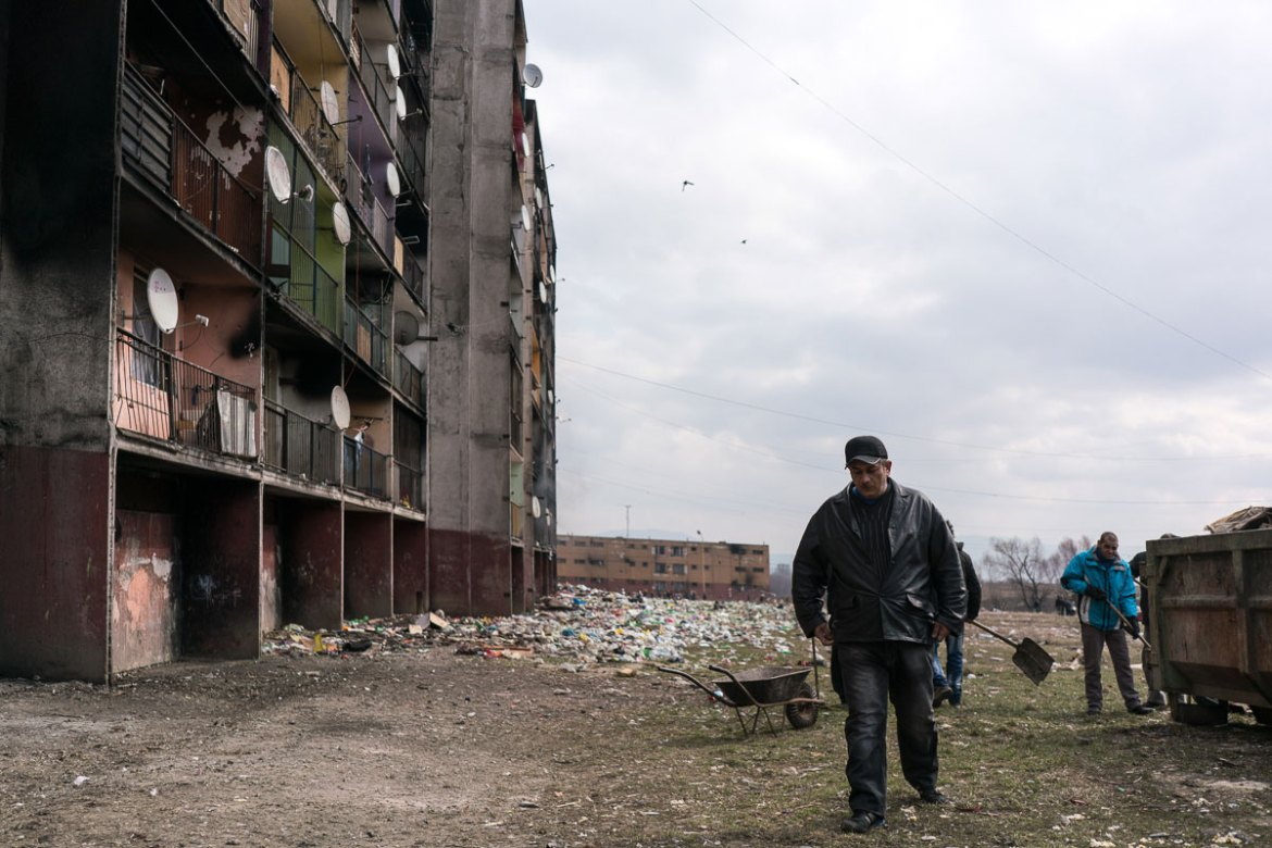 Ondrej Fercack, 43, participates in a programme where he sweeps the neighbourhood as a prerequisite for receiving his welfare cheques. [Sorin Furcoi/Al Jazeera]