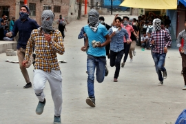 Clashes between rock-throwing protesters and government forces are frequent in Kashmir [Danish Ismail/Reuters]